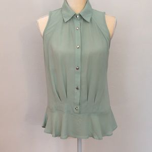 Light green sleeveless blouse.